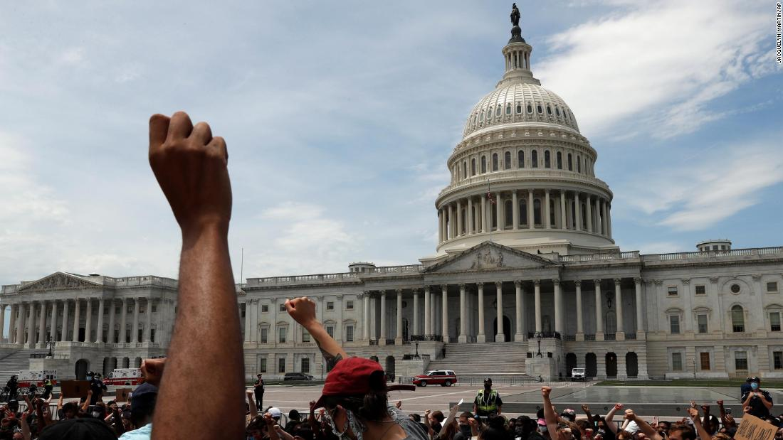 Demonstrators protest the death of George Floyd as they gather Wednesday, June 3, 2020, on the East side of the U.S. Capitol in Washington. Floyd died after being restrained by Minneapolis police officers.