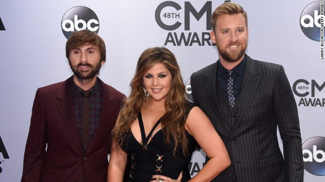 Dave Haywood, Hillary Scott, and Charles Kelley of Lady Antebellum attend the 48th annual CMA Awards at the Bridgestone Arena on Wednesday, November 5, in Nashville, Tennessee.