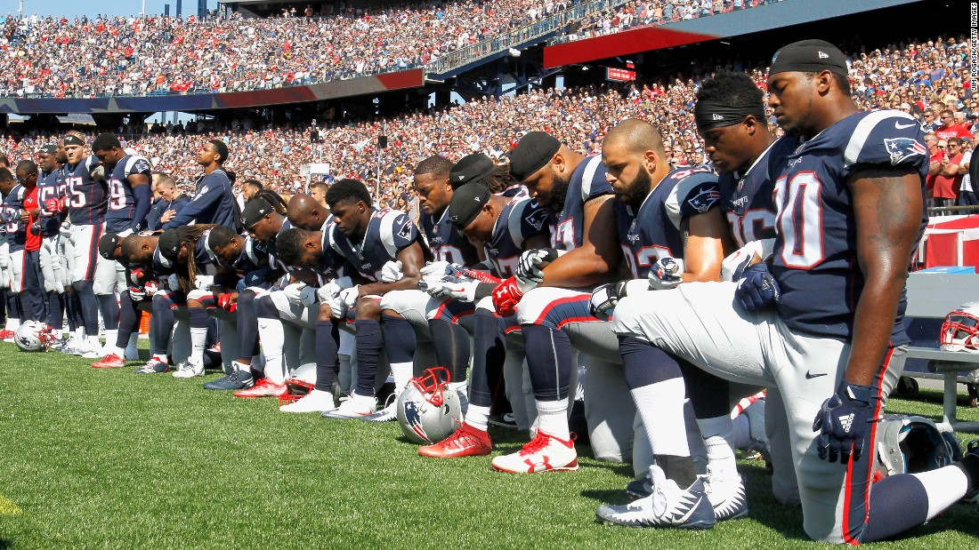 Members of the New England Patriots kneel during the National Anthem before a game. The NFL announced on Thursday it would pledge $250 million over the next ten years to help fight systematic racism.