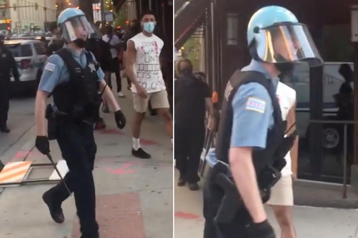 Polisi Chicago menangkap teriakan cercaan homofobia pada pengunjuk rasa: video